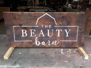 Beauty Barn rustic business sign on barn board