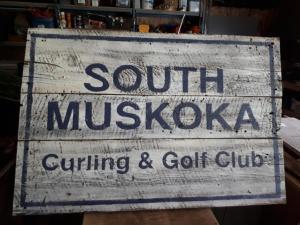 South Muskoka Curling Club sign on barn board