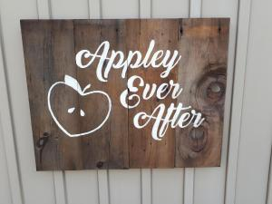 Appley Ever After wedding sign on barnboard