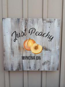 Just Peachy Winnona sign on barnboard